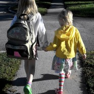 Free Two Happy Girls Holding Hands Walking to School at Sunrise Creative Commons