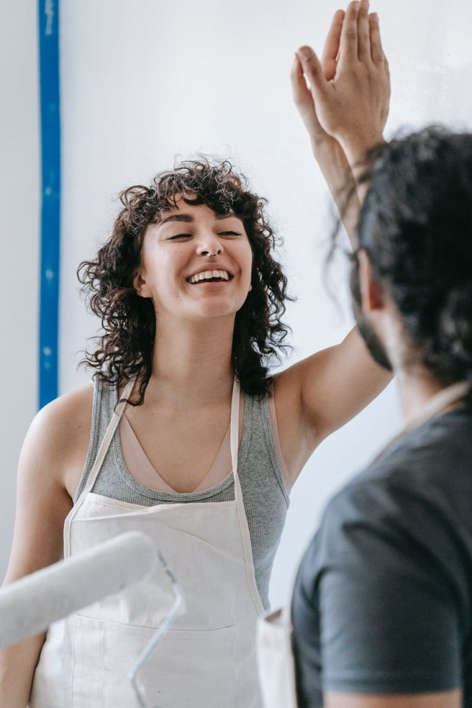 smiling woman doing high five